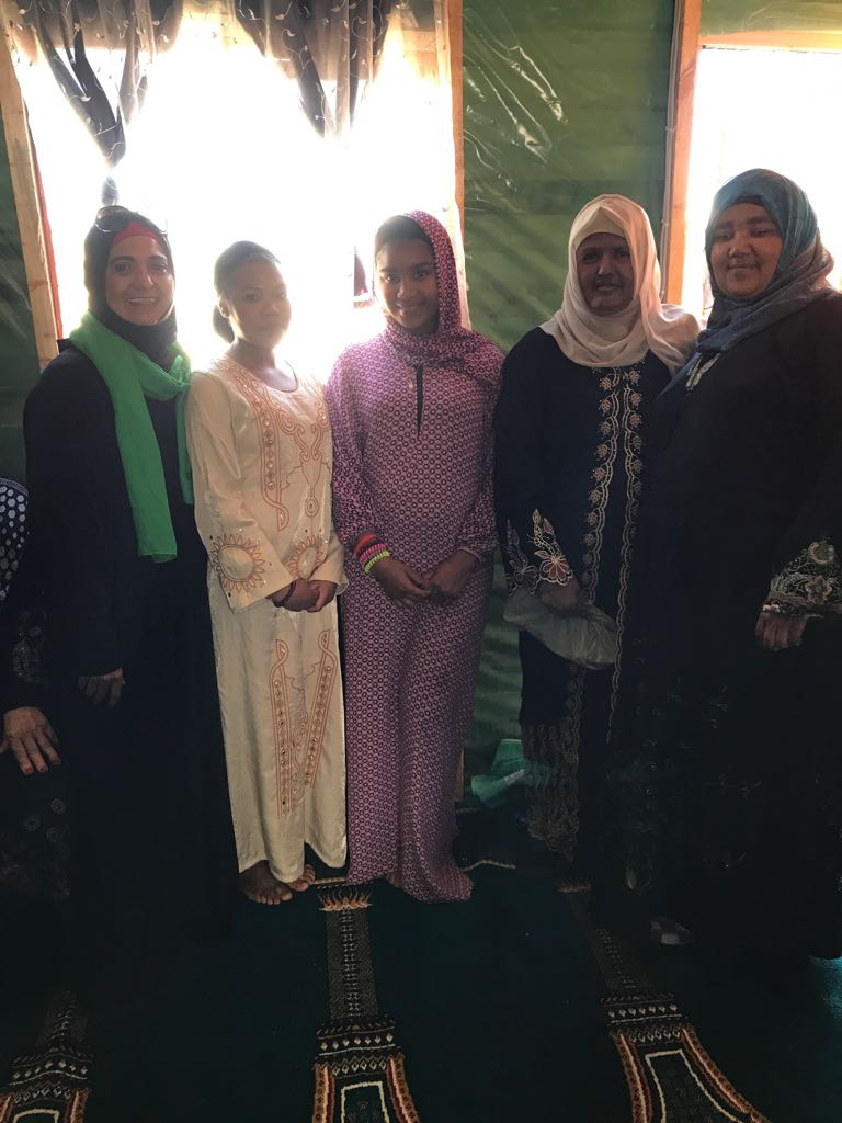 The sister (second from left) embraced Islam whilst the delegation was present.