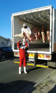 The trucks transported all the meat to the various locations.