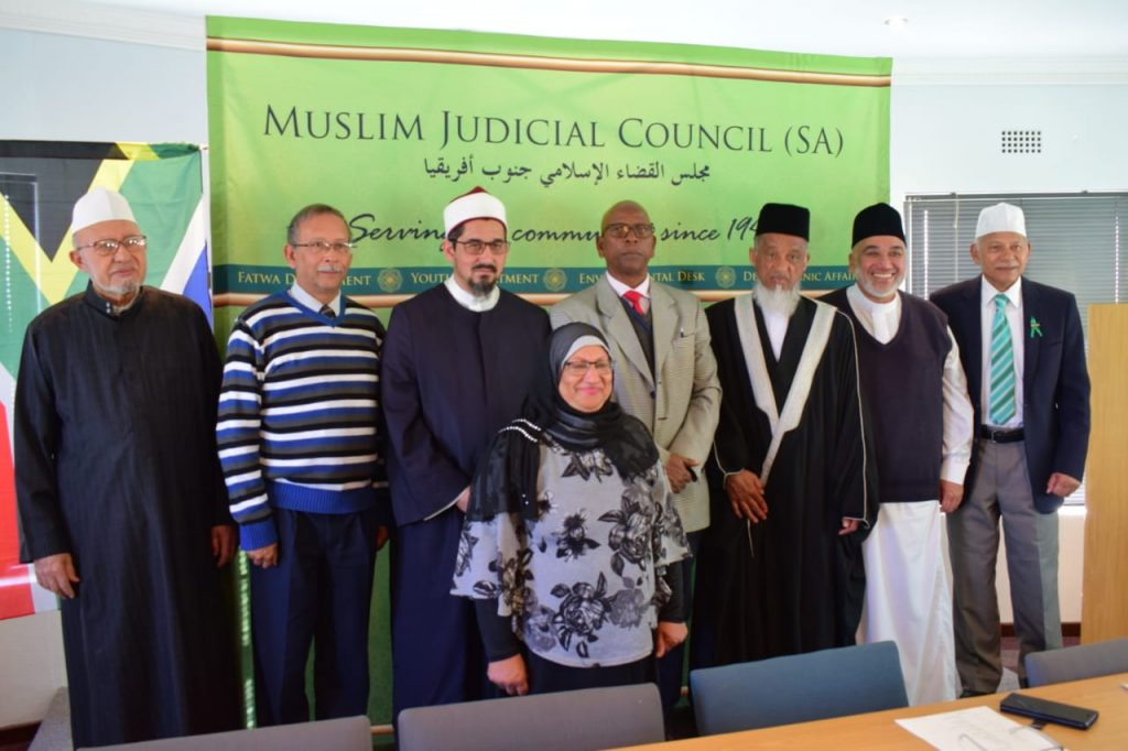 "Hufaath Academic project committee: From left: Shaykh Abdul Moutie Moerat (MJC Senior Council member), Mr Saul Philander (WCED representative), Shaykh Riad Fataar (MJC Head of Education), Mr Jerry Mofaka (WCED representative), Shaykh Irafaan Abrahams (MJC President), Shaykh Shahid Esau (MJC Imaarah member), Mr Goosain Emeran (Education Advisor). Front row: Nazeema Omar (administrator for the project). Absent: Nazlie Domingo (WCED representative)  launch of historic ""mjc hufaath academic support programme"" - WhatsApp Image 2018 07 18 at 11 - Launch of historic ""MJC Hufaath Academic Support programme"""